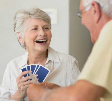 happy-senior-couple-playing-a-card-game