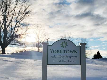 YRNC---Outside-Snow-with-Sign_c